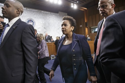 Attorney general nominee Loretta Lynch is escorted by her security detail on Capitol Hill in Washington, Wednesday, Jan. 28, 2015, as the Senate Judiciary Committee takes a break during her confirmation hearing. She is now the U.S. Attorney for the Eastern District of New York. If confirmed, Lynch would replace Attorney General Eric Holder, who announced his resignation in September after leading the Justice Department for six years. (AP Photo/J. Scott Applewhite)