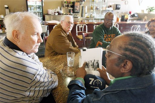 In this Jan. 23, 2009, file photo, Elwin Wilson, left, and Friendship 9 member Willie McCleod, right, look over pictures from civil rights incidents in Rock Hill, S.C., in the 1960s. The criminal record will soon be erased for the nine black men arrested for integrating a whites-only South Carolina lunch counter 54 years ago. On Wednesday, Jan. 28, 2015,  prosecutor is expected to ask a judge to vacate the arrests and convictions of the men known as the Friendship 9. (AP Photo/Herald, Andy Burriss, File)