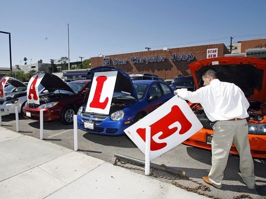 Used cars are offered for sale in Glendale, Calif., in this 2007 file photo (Damian Dovarganes/AP Photo)