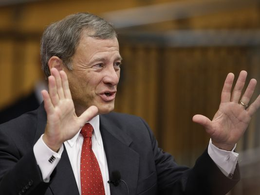 Under Chief Justice John Roberts, the Supreme Court has scaled back civil rights laws. (Nati Harnik/AP Photo)