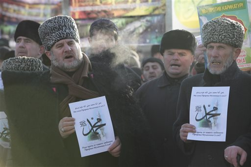 Chechen Muslims march in downtown regional capital of Grozny to take part in a protest rally on Monday, Jan. 19, 2015. Tens of thousands of people have marched in the Russian region of Chechnya to rally against the French satirical magazine Charlie Hebdo. (AP Photo/Musa Sadulayev)