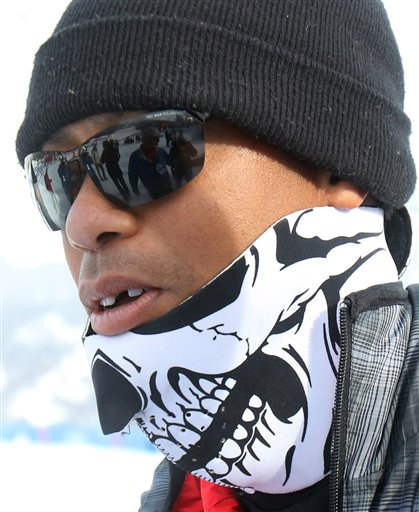 Tiger Woods walks in the finish area of an alpine ski, women's World Cup super-G, in Cortina d'Ampezzo, Italy, Monday, Jan. 19, 2015. Lindsey Vonn won a super-G Monday for her record 63rd World Cup victory and celebrated with an embrace from a surprise visitor ó boyfriend Tiger Woods. The American broke Annemarie Moser-Proell's 35-year-old record of 62 World Cup wins with a flawless run down the Olympia delle Tofane course, finishing 0.85 ahead of Anna Fenninger of Austria. (AP Photo/Armando Trovati)