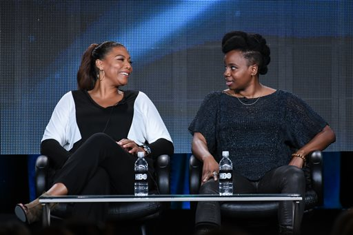 "Queen Latifah, left, and writer/director Dee Rees speak on stage at HBO 2015 Winter TCA on Thursday, Jan. 8, 2015, in Pasadena, Calif. Executive Producer, Latifah, also stars as Bessie Smith in the HBO Films drama, ""Bessie,"" debuting Spring 2015.  (Photo by Richard Shotwell/Invision/AP)"