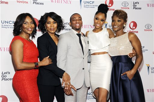 "Actress Angela Bassett, second from left, making her directorial debut with the Lifetime film ""Whitney,"" poses with cast members, left to right, Suzzanne Douglas, Arlen Escarpeta, Yaya DaCosta and Yolonda Ross at the premiere of the film at the Paley Center for Media on Tuesday, Jan. 6, 2015, in Beverly Hills, Calif. (Photo by Chris Pizzello/Invision/AP)"