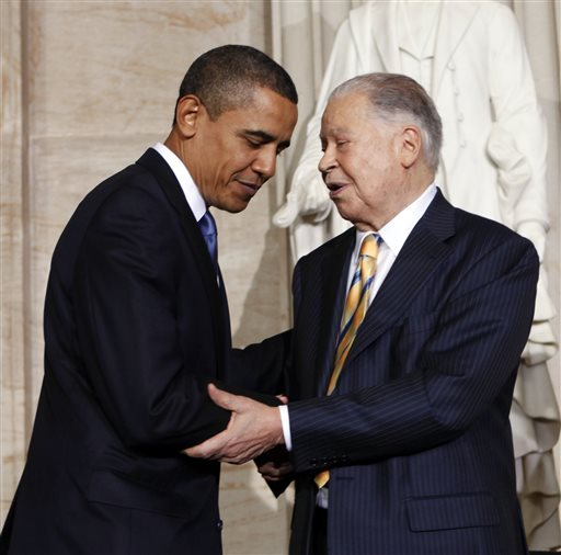 File-This Oct. 28, 2009, file photo shows President Barack Obama greeting former Massachusetts Sen. Edward Brooke in the Rotunda on Capitol Hill in Washington, during a ceremony where Brooke received the Congressional Gold Medal. Brooke, the first black to win popular election to the Senate, has died. He was 95. Ralph Neas, a former aide, said Brooke died Saturday, Jan. 3, 2015, of natural causes at his Coral Gables, Fla, home. (AP Photo/Gerald Herbert, File)