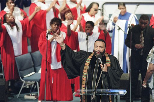"In this Sept. 1, 1996 file photo, Grammy winning gospel singer Andrae Crouch sings during service at the Christ Memorial church in Pacoima, Calif. Crouch, a legendary gospel performer, songwriter and choir director whose work graced songs by Michael Jackson and Madonna and movies such as ""The Lion King,"" has died at age 72. His publicist says Crouch died Thursday, Jan. 8, 2015, at a hospital in Los Angeles, where he was admitted Saturday after suffering a heart attack.  (AP Photo/Frank Wiese, File)"