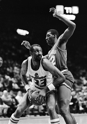 FILE - In this April 1, 1988, file photo, Washington Bullets' Charles Jones, left, drives for the basket against Dallas Mavericks' Roy Tarpley during an NBA basketball game in Landover, Md. Tarpley, the former Mavericks star center whose NBA career was cut short by drug abuse, has died. He was 50. A Tarrant County medical examiner's report says Tarpley died Friday afternoon, Jan. 9, 2015, at Texas Health Arlington Memorial Hospital. No cause of death was given in the online report. (AP Photo/File)