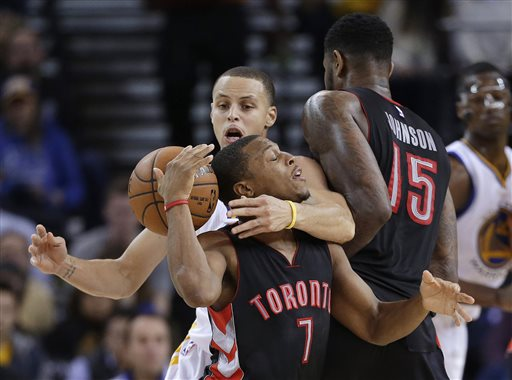 Golden State Warriors' Stephen Curry strips the ball from Toronto Raptors' Kyle Lowry (7) during the second half of an NBA basketball game Friday, Jan. 2, 2015, in Oakland, Calif. Golden State won 126-105. (AP Photo/Marcio Jose Sanchez)