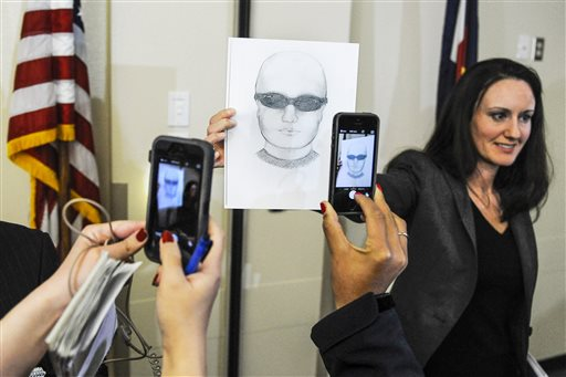 FBI spokeswoman Amy Sanders holds up a sketch of a person of interest in the bombing of the Colorado Springs chapter of the NAACP after a press conference with local and national law enforcement agencies Friday, Jan. 9, 2015 at the Colorado Springs Police Operations Center. The FBI is offering a $10,000 reward for anyone with information leading to an arrest. (AP Photo/The Colorado Springs Gazette, Michael Ciaglo)