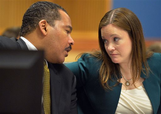 Dexter Scott King talks with attorney Nicole Wade during a hearing over who owns the Rev. Martin Luther King Jr.'s 1964 Nobel Peace Prize medal and traveling Bible on Tuesday, Jan. 13, 2015 in Fulton County Superior Court in Atlanta.  King's estate, which is controlled by his sons, last year asked a judge to order King's daughter to surrender the items. In a board of directors meeting, Martin Luther King III and Dexter Scott King voted 2-1 against Bernice King to sell the two artifacts to a private buyer.  (AP Photo/Atlanta Journal-Constitution, Kent D. Johnson)  MARIETTA DAILY OUT; GWINNETT DAILY POST OUT; LOCAL TELEVISION OUT; WXIA-TV OUT; WGCL-TV OUT