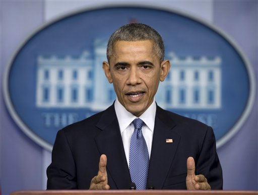 In this Dec. 19, 2014 file photo, President Barack Obama speaks during a news conference in the Brady Press Briefing Room of the White House in Washington. In the White House, President Barack Obama has preached economic opportunity and equal access to education as cornerstones of the legacy he says he wants to leave behind. But in the contest to host his presidential library, two public universities that serve needy communities fear the playing field has been tilted against them by a pair of elite, private schools with seemingly endless funding. (AP Photo/Carolyn Kaster, File)