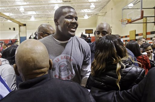 Ohio State quarterback Cardale Jones leaves  a news conference in Cleveland Thursday, Jan. 15, 2015, after announcing he would not declare for the 2015 NFL draft. Jones, 3-0 as a college starter including a win in the national championship game, says he will return to the Buckeyes for his final two years of eligibility. (AP Photo/Mark Duncan)