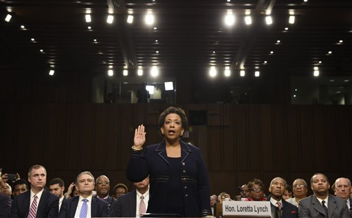 Attorney General nominee Loretta Lynch is sworn in on Capitol Hill in Washington, Wednesday, Jan. 28, 2015, prior to testifying before the Senate Judiciary Committee's hearing on her nomination. If confirmed, Lynch would replace Attorney General Eric Holder, who announced his resignation in September after leading the Justice Department for six years. The 55-year-old federal prosecutor would be the nation's first black female attorney general. (AP Photo/Susan Walsh)