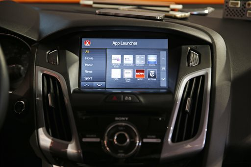 The OpenAir I1.3 infotainment system is on display in a car at the Visteon booth Thursday, Jan. 8, 2015, at the International CES in Las Vegas. The technology allows you to to access your smart phone and its apps from the touch screen in your car. (AP Photo/John Locher)
