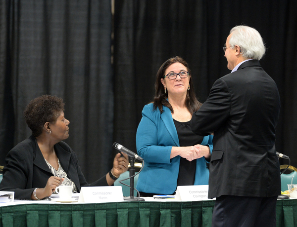 Vermont Attorney General Bill Sorrell, right, confers with Commissioners Theresa Martha Covington (center) and Patricia M. Martin (left) before the CECANF public meeting in Burlington, Vermont, on October 23, 2014. (Alison Redlich/AP Images for CECANF)