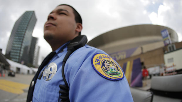 New Orleans police officer J. Almedia stands on patrol outside the Superdome, site of Super Bowl XLVII, Jan. 29, 2013, in New Orleans. (Charlie Riedel/AP Photo)