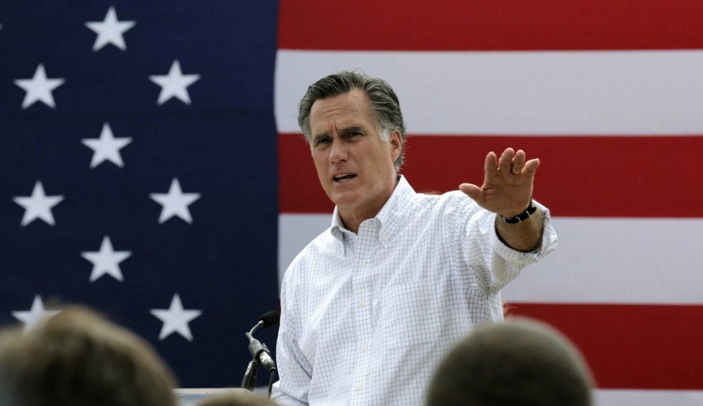 In this July 2, 2014, file photo, former GOP presidential nominee Mitt Romney addresses a crowd of supporters in New Hampshire. Romney told a small group of donors that he's considering a third run at the White House. (Charles Krupa/AP)