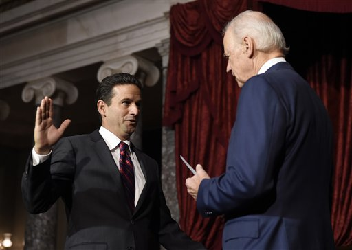 "In this Dec. 2, 2014 file photo, Vice President Joe Biden administers the Senate oath to Sen. Brian Schatz, D-Hawaii during a ceremonial swearing-in ceremony in the Old Senate Chamber on Capitol Hill in Washington. Congressional Democrats are on a retreat in more ways than one this week. As Democratic lawmakers gather in Baltimore to talk strategy and lick election wounds, their party faces diminished powers in Congress, GOP dominance in the states, and a shrinking pool of potential candidates for future elections. The picture is especially bleak in the South, where some Democrats hope courts will overturn GOP-controlled ""gerrymandering"" of congressional and state legislative districts. Elsewhere, Democrats in swing states say their party must get better at highlighting the improved economy and the surge in energy production under President Obama. (AP Photo/Susan Walsh, File)"