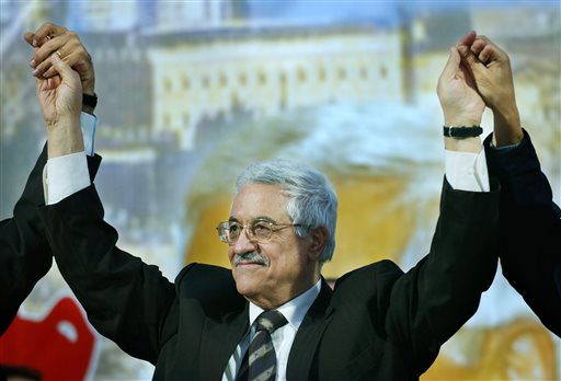 In this Dec. 28, 2004 file photo, Interim Palestinian leader and presidential front-runner Mahmoud Abbas raises his arms on the stage during a campaign rally in the West Bank town of Jericho. After a decade in power, Abbas is no closer to a deal on Palestinian statehood, has failed to reclaim the Gaza Strip from political rival Hamas and is being disparaged by some as a pliant guardian of Israeli security needs in the West Bank. He dramatically changed course in January 2015 by signing up to the International Criminal Court, a move that  could allow for war crimes complaints against Israel. (AP Photo/Nasser Nasser, File)