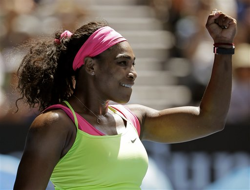 Serena Williams of the U.S. celebrates after defeating Dominika Cibulkova of Slovakia in   their quarterfinal match at the Australian Open tennis championship in Melbourne, Australia, Wednesday, Jan. 28, 2015. (AP Photo/Bernat Armangue)
