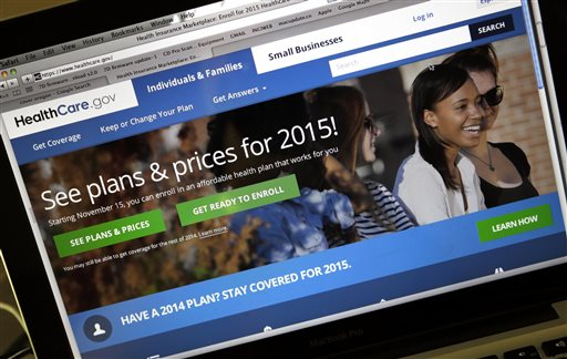 This Nov. 12, 2014 file photo shows the HealthCare.gov website, where people can buy health insurance, on a laptop screen, shown in Portland, Ore. Not only do more Americans have health insurance, but the number struggling with medical costs has dropped since President Barack Obama's health care law expanded coverage, according to a study released Thursday Jan. 15, 2015. (AP Photo/Don Ryan, File)