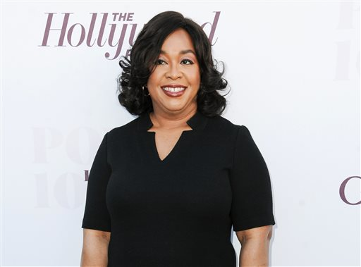 """In this Dec. 10, 2014, file photo, Shonda Rhimes arrives at the The Hollywood Reporter's Women In Entertainment Breakfast in Los Angeles. Rhimes is arguably the most powerful producer in television these days. ABC has turned over to her its entire Thursday night lineup, where she delivers weekly episodes of """"Grey's Anatomy,"""" """"Scandal"""" and """"How to Get Away With Murder."""" (Photo by Richard Shotwell/Invision/AP, File)"""