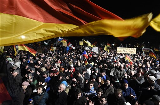 In this Monday, Jan. 12, 2015 file photo, demonstrators bear flags of several European countries during a rally of the group Patriotic Europeans against the Islamization of the West, or PEGIDA, in Dresden, Germany. Firebombs and pigs' heads are being tossed at mosques and women in veils have been insulted in a surge of anti-Muslim acts since last week's murderous assault on the newsroom of a satirical Paris paper, according to a Muslim who tracks such incidents in France. France's large Muslim population risks becoming collateral damage in the aftermath of the three attacks by French radical Islamists who killed 17 people. Muslims in other European countries also won't be spared, some Muslim leaders and experts say. Concern about a backlash against Muslims was discussed Monday Jan. 13, 2015, during a meeting on counter-terrorism measures at the Interior Ministry. (AP Photo/Jens Meyer, File)