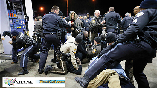 Police try to control a crowd, Dec. 24, on the lot of a gas station following a shooting in Berkeley, Mo. (The Final Call)