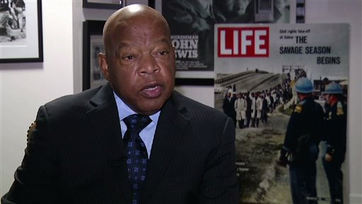 "In this Dec. 22, 2014 image taken from video, U.S. Rep. John Lewis, D-Ga., discusses the historical drama ""Selma"" and civil rights in the United States during an interview in Atlanta. Forty-nine years after Lewis and other marchers tried to cross the Edmund Pettus Bridge in Selma, Ala., memories of ""Bloody Sunday"" are still vivid in his mind. It was one of the defining moments of the civil rights era. (AP Photo/Alex Sanz)"
