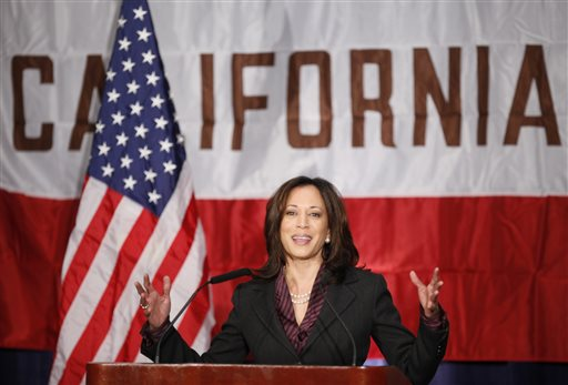 In this Nov. 30, 2010 file photo, California Attorney General Kamala Harris gives her first news conference in Los Angeles. California Sen. Barbara Boxer announced Thursday, Jan. 8, 2015, that she will not seek re-election in 2016. An adviser with knowledge of her plans says California Attorney General Kamala Harris will announce Tuesday, Jan. 13, 2015 that she will seek the U.S. Senate seat being vacated by Sen. Barbara Boxer. (AP Photo/Damian Dovarganes, File)