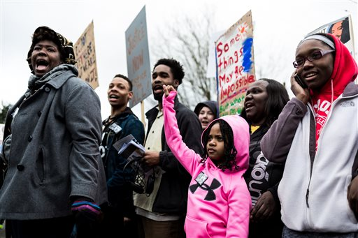 Photo of MLK Honored; Scattered Protests Over Black Deaths by Police