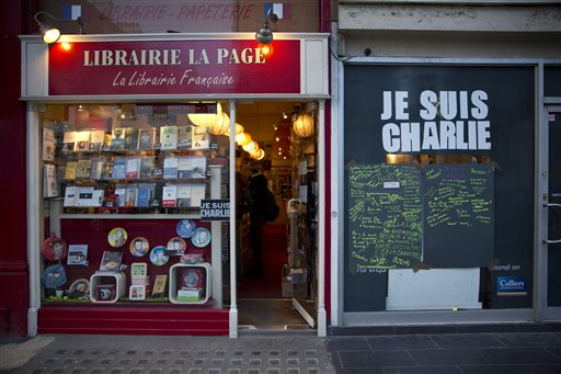 "A French bookshop, where staff expect to get copies of  the latest edition of French satirical magazine Charlie Hebdo in stock to go on sale on Friday, is seen with a large ""I am Charlie"" sign next to the entrance in London, Wednesday, Jan. 14, 2015.  Charlie Hebdo's defiant new issue sold out before dawn around Paris on Wednesday, with scuffles at kiosks over dwindling copies of the paper fronting the Prophet Muhammad.  (AP Photo/Matt Dunham)"