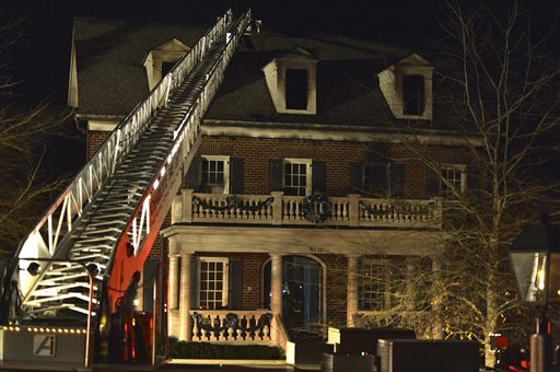 A ladder from a Charlotte Fire Department hook-and-ladder truck is shown outside a house owned by Carolina Panthers NFL football coach Ron Rivera in Charlotte, N.C., early Monday, Jan. 5, 2015. Rivera's house suffered fire, water and smoke damage in an early morning blaze but no one was injured, Charlotte Fire Department spokesman said. (AP Photo/The Charlotte Observer, David Hindshaw)
