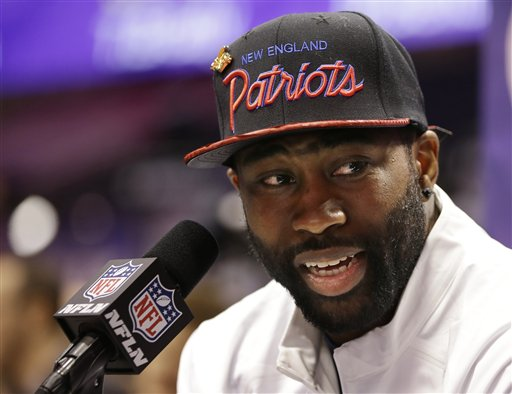 New England Patriots' Darrelle Revis answers questions during media day for NFL Super Bowl XLIX football game Tuesday, Jan. 27, 2015, in Phoenix. (AP Photo/Mark Humphrey)
