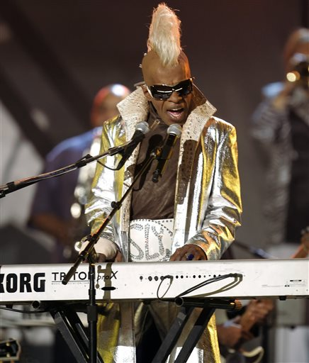 In this Feb. 8, 2006 file photo, Sly Stone from the group Sly and the Family Stone performs at the Grammy Awards in Los Angeles. A Los Angeles jury has awarded $5 million to funk legend Stone in a breach-of-contract suit against his business partners. Jurors on Tuesday, Jan. 27, 2015, found that Stone's ex-manager Gerald Goldstein, attorney Glenn Stone and the company Even Street Productions owed him royalties. (AP Photo/Mark J. Terrill, File)