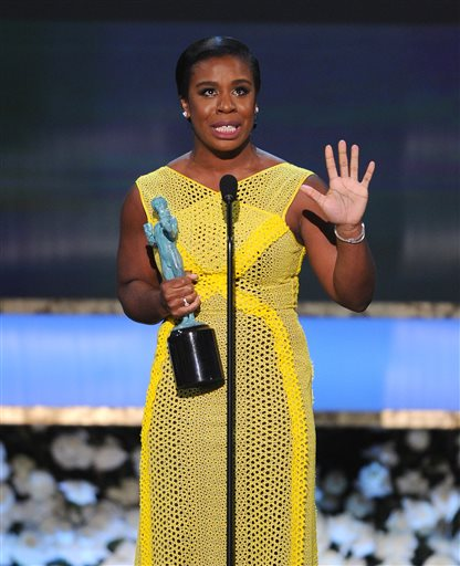 "Uzo Aduba accepts the award for outstanding female actor in a comedy series for ""Orange is the New Black"" on stage at the 21st annual Screen Actors Guild Awards at the Shrine Auditorium on Sunday, Jan. 25, 2015, in Los Angeles. (Photo by Vince Bucci/Invision/AP)"