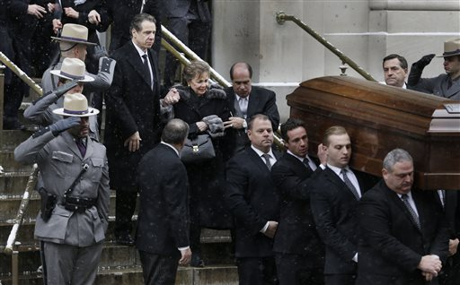 New York Governor Andrew Cuomo and his mother Matilda Cuomo follow a casket containing the body of Mario Cuomo as it is carried from the church during his funeral in New York, Tuesday, Jan. 6, 2015. (AP Photo/Seth Wenig)