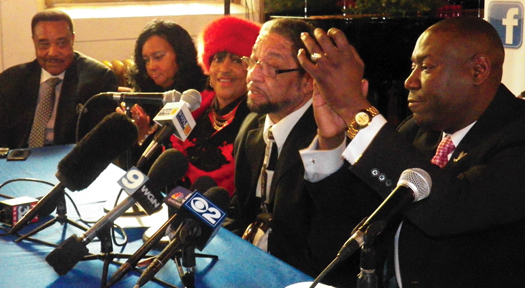 Left to right: Leonard F. Muhammad of the Nation of Islam, Bishop Connie Bansa of Church of the Living God, Rosalind Morgan, Howard Morgan, Atty. Benjamin Crump, radio host Cliff Kelley at a press conference discussing the commuted sentence of Mr. Morgan by former Illinois Gov. Pat Quinn.(Starla Muhammad/The Final Call)