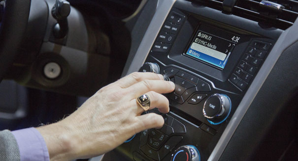 A car radio playing Sirius XM is pictured. (AP Photo/Julie Jacobson)