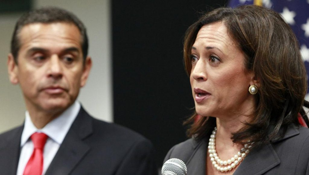 Attorney General Kamala Harris, right with Los Angeles Mayor Antonio Villaraigosa, speaks at a news conference regarding criminal and civil responses to mortgage fraud in Los Angeles Monday, May 23, 2011. (AP Photo/Nick Ut)