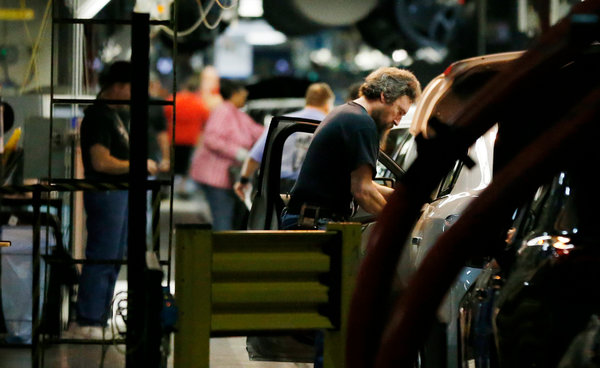 The assembly line at the General Motors Fairfax plant in Kansas City, Mo. G.M. said union workers would receive profit-sharing checks that exclude the costs of recalls. (Orlin Wagner/Associated Press)