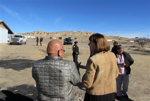 This Saturday, Jan. 24, 2015 photo provided by Ron Lee, Office of Rep. Ann Kirkpatrick shows Democratic U.S. Rep. Ann Kirkpatrick of Arizona, right, speaks with tribal members on the Hopi reservation in northeastern Arizona. Members of Congress are trying to figure out to close out the Office of Navajo-Hopi Indian Relocation, tasked with providing homes to Navajos and Hopis who were ordered removed from each other's land.  (AP Photo/Office of Rep. Ann Kirkpatrick, Ron Lee)