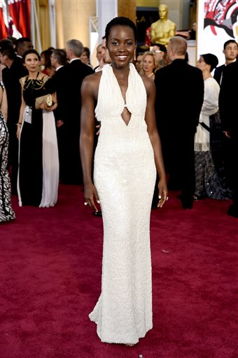 In this Feb. 22, 2015 file photo, actress Lupita Nyong'o arrives at the Oscars wearing a dress made of pearls at the Dolby Theatre in Los Angeles.  Los Angeles sheriff's detectives are investigating the theft of the $150,000 custom Calvin Klein dress worn by Nyong'o at the 2015 Academy Awards. The dress was reported stolen from Nyong'o's West Hollywood hotel room late on Wednesday Feb. 25, 2015. (Photo by Chris Pizzello/Invision/AP)