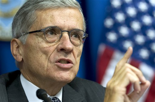 In this Oct. 8, 2014 file photo, Federal Communications Commission (FCC) Chairman Tom Wheeler speaks during new conference in Washington. Internet service providers, including those selling wireless connections, would be prohibited from slowing down or speeding up web traffic, under rules proposed Wednesday by a top U.S. regulator that would subject the broadband industry to unprecedented regulation. In an op-ed to Wired magazine posted online, Wheeler said his plan would regulate Internet service much like phone service or any other public utility by applying Title II of the 1934 Communications Act. Wheeler said he would not use the new regulations to tell broadband providers how much to charge customers or to impose tariffs. Industry has fought against this approach, contending that it would only be a matter of time before the rules grow more stringent and discourage investment. (AP Photo/Jose Luis Magana, File)
