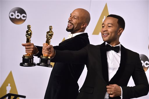 "Common, left, and John Legend pose in the press room with the award for best original song in a feature film for ""Glory"" from ""Selma"" at the Oscars on Sunday, Feb. 22, 2015, at the Dolby Theatre in Los Angeles. (Photo by Jordan Strauss/Invision/AP)"
