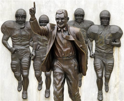 This is the statue of former Penn State University head football coach Joe Paterno that stands outside Beaver Stadium in State College, Pa., in this Friday, July 13, 2012 file photo. The Quinnipiac University poll released Wednesday Feb. 11, 2015 said the majority — 59 percent to 25 percent — favored restoring the statue to a prominent place on campus. (AP Photo/Gene J. Puskar, File)
