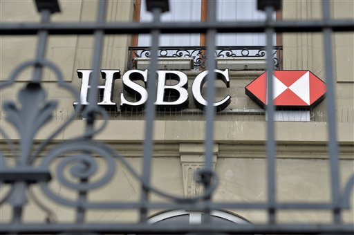 The logo of HSBC Private Bank is pictured in Geneva, Switzerland, Wednesday. Feb. 18, 2015.  Geneva prosecutors searched the premises of HSBC's Swiss subsidiary on Wednesday, after launching a money-laundering investigation over a report that the bank helped hide millions of dollars for drug traffickers, arms dealers and celebrities.  (AP Photo/Keystone,Martial Trezzini)