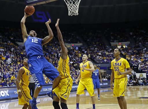 Kentucky forward Karl-Anthony Towns (12)  goes to the basket against LSU forward Jordan Mickey in the second half of an NCAA college basketball game in Baton Rouge, La., Tuesday, Feb. 10, 2015. Kentucky won 71-69. (AP Photo/Gerald Herbert)