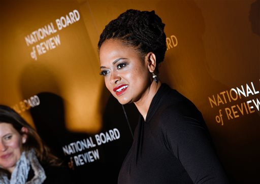 "In this Jan. 6, 2015 file photo, Ava DuVernay, director of ""Selma,"" attends the National Board of Review awards gala in New York.  DuVernay and Oprah Winfrey are creating a drama series for Winfrey's TV channel. The project is inspired by the Natalie Baszile novel ""Queen Sugar,"" the OWN channel said Monday, Feb. 2. Winfrey will serve as executive producer and will play a recurring role _ the first time she's acted in a series for OWN, the network said. (Photo by Evan Agostini/Invision/AP, File)"