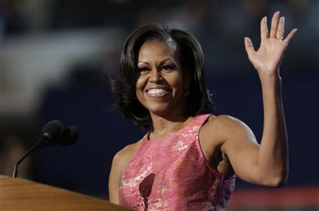 First Lady Michelle Obama waves to delegates at the Democratic National Convention in Charlotte, N.C., on Monday, Sept. 3, 2012. The dress she is wearing was made by African-American designer Tracy Reese. (AP Photo/David Goldman)